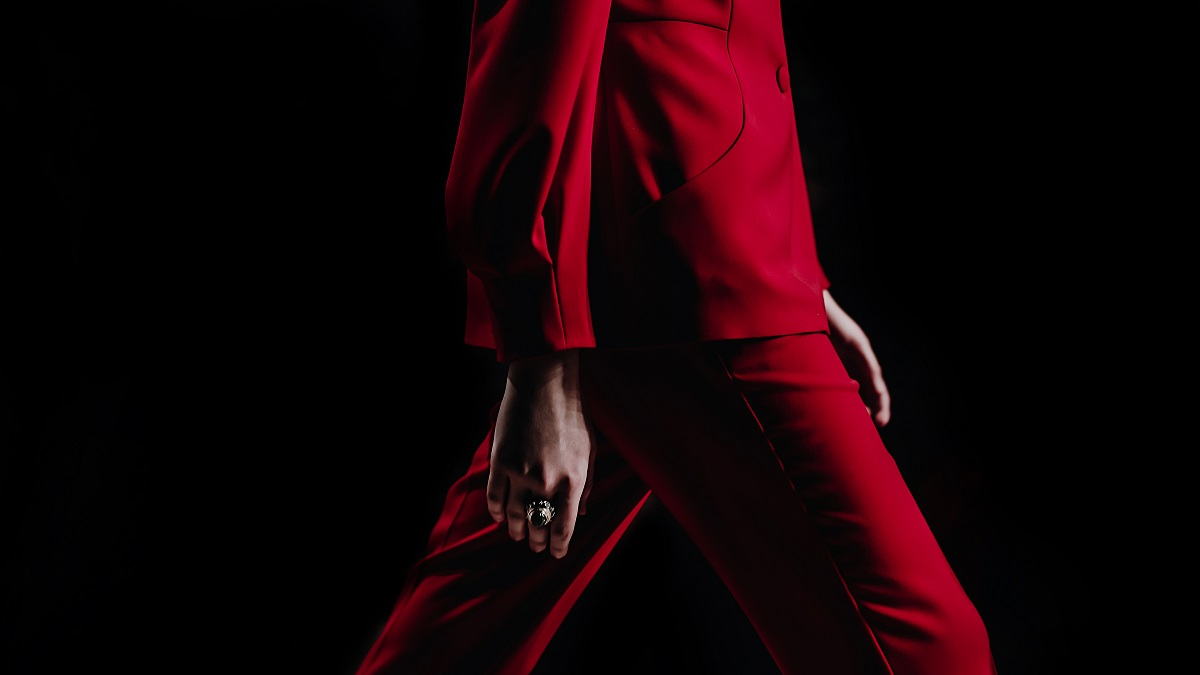 Close-Up Details Of Clothing On A Woman Model In Red Suit Walks On The Fashion Show