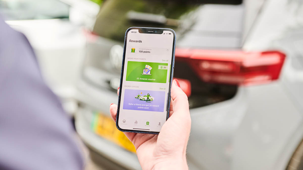 Person looking at phone with ev.energy app on it