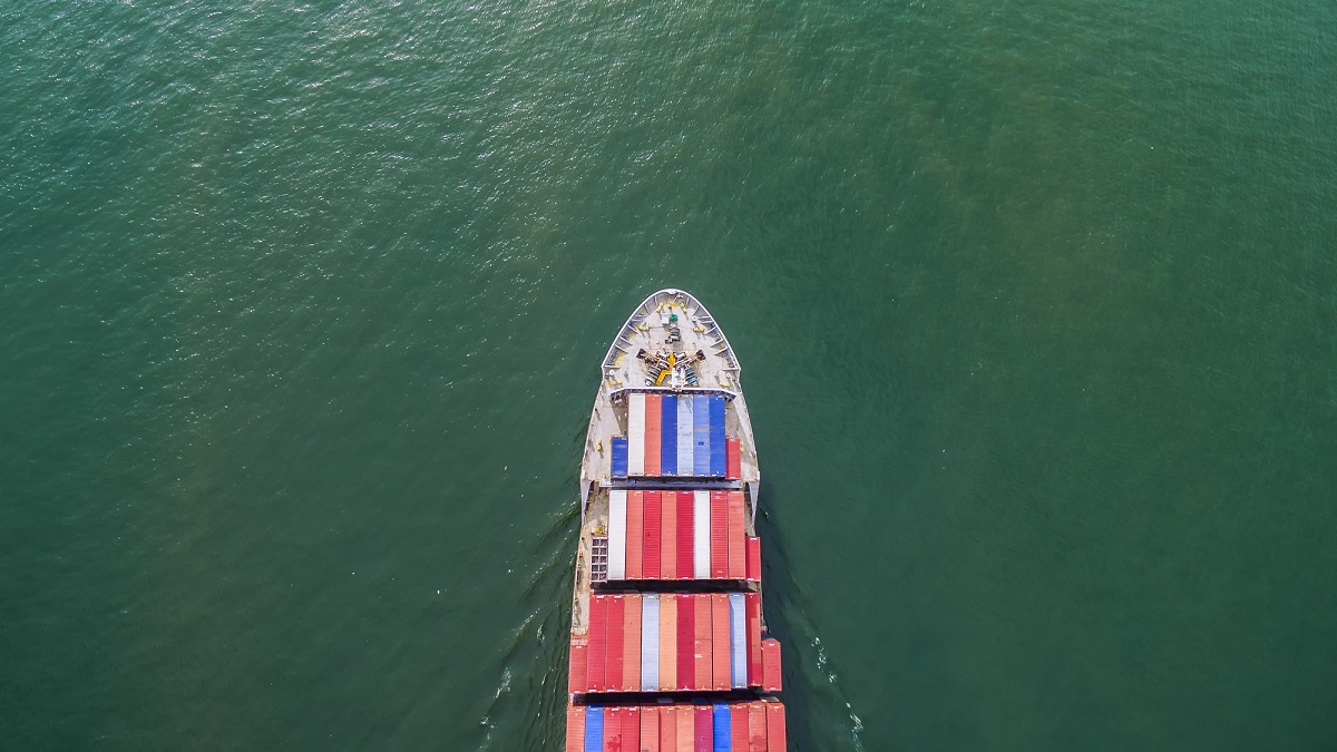 aeriel view container shipping by container ship by green sea .