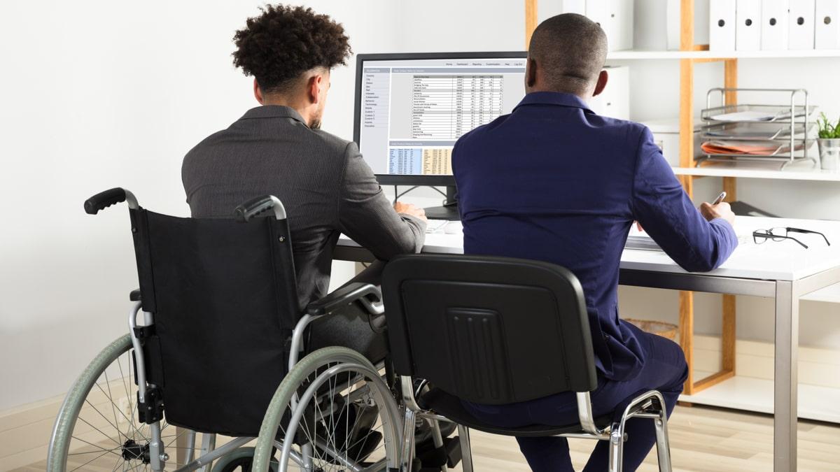 Wheelchair user working at desk